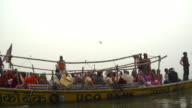 Boat with pilgrims in Ganges River