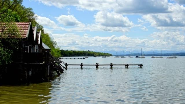 Boathouses on Lake Ammersee in spring, Inning Stegen, Fuenfseenland, Upper Bavaria, Bavaria, Germany