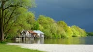 Boathouses on Lake Ammersee in spring, Inning Stegen, Fuenfseenland, Upper Bavaria, Bavaria, Germany
