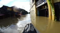 Boating along flooded streets in historic Hoi An old quarter, Vietnam