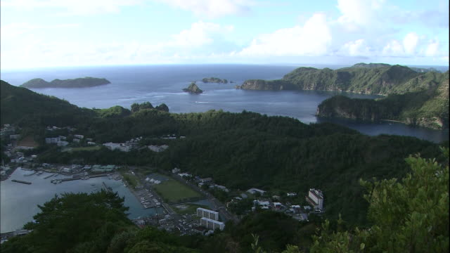 Boats and ships float in Futami Bay on Chichijima Island in Japan.