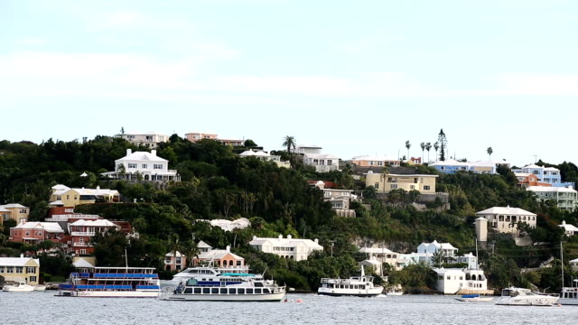 Boats and yachts sit in the water as houses dot the hillside along Hamilton Harbour November 8 2017 in Hamilton Bermuda In a series of leaks made...