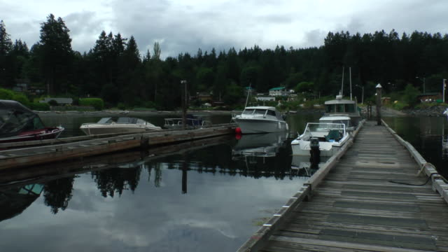 Boats are docked by the pier in Gorge Harbor near Cortes Island, British Columbia.