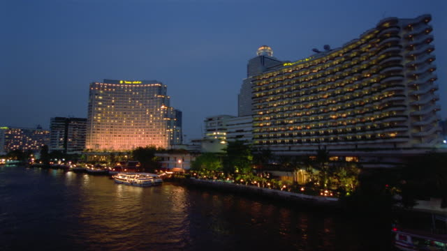 FAST MOTION, HA, MS, Boats at riverbank at dusk, Bangkok, Thailand