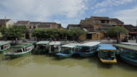 BOAT POV WS Boats Moored by Side of River / Hoi An, Vietnam
