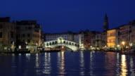 T/L WS Boats on Grand Canal near Ponte Rialto, dusk to night / Venice, Italy