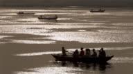 WS TS Boats passing across Gangas river at sunset / Varanasi, Uttar Pradesh, India