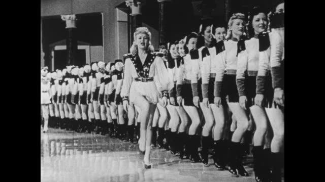Bob Hope introduces a musical number led by Betty Grable