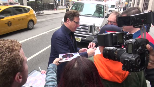 Bob Saget arrives at The Huffington Post signs for fans before going in in Celebrity Sightings in New York