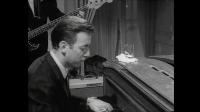 Bobby Darin playing piano Go Go party People dancing 'the pony' style wild go go dancers Set of movie 'Madame X '
