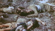 Bodies of dead Japanese civilians and soldiers at base of cliff from mass suicide during World War II
