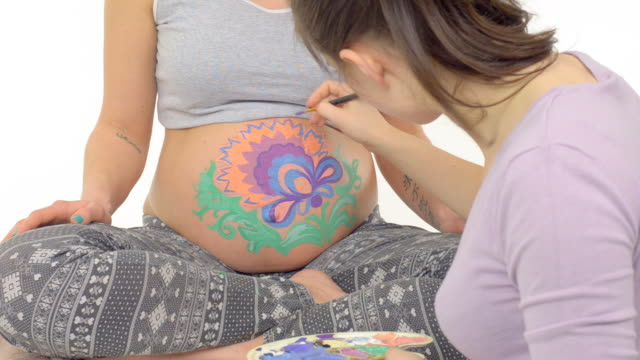 Body art on the belly of pregnant woman