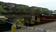 Body found in suitcase recovered from Grand Union Canal ENGLAND West London Little Venice EXT Narrow boats moored on canal and cordon tape across tow...