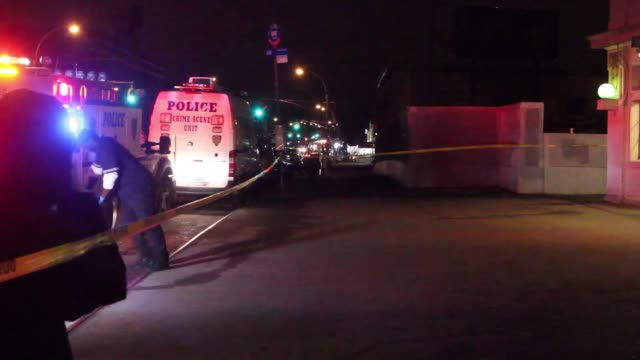 A body is brought out after two police officers were shot and then killed a perpetrator after an altercation on the N Train in Brooklyn at Fort...