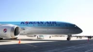 A Boeing Co 7879 Dreamliner passenger aircraft operated by Korean Air Lines Co stands on the tarmac outside a hangar during a media preview at...