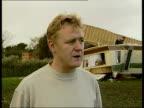 BEN MCCARTHY ENGLAND Sussex Bognor Regis Damaged caravan PULL OUT upturned caravan lying on top MS Damaged furniture inside caravan GV Upturned...