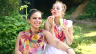 Boho girls surrounded by nature in spring having fun