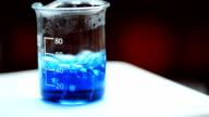 Boiling blue liquid in beaker