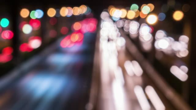Bokeh cirkel licht wazig time-lapse lange blootstelling van weg tijdens de nacht in de centrale stad, Time-lapse beweging, 4k(UHD)