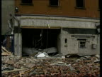 Bomb attacks in Belfast and Lurgan NIRELAND GV Main st with wrecked shops and Armagh extensive bomb damage PAN RL Lurgan TMS Rubble on floor PULL OUT...