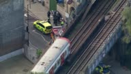 Bomb explodes on Tube train at Parsons Green AIR VIEW / AERIAL District Line train at staion after bomb and police cordon at Parson's Green