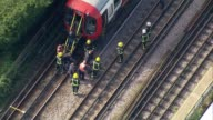 Bomb explodes on Tube train at Parsons Green AIR VIEW / AERIAL passengers from tube train onto tracks