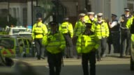 Bomb explodes on Tube train at Parsons Green ENGLAND London Parsons Green EXT Police officers along on road Police officer lifting corden tape Police...