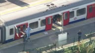 Bomb explodes on Tube train at Parsons Green **Shuchen Warner interview overlaid SOT** Forensic officers and police officers on platform next to Tube...