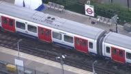 Bomb explodes on Tube train at Parsons Green Witness accounts AIR VIEW Tube train at platform forensic tent partly in shot