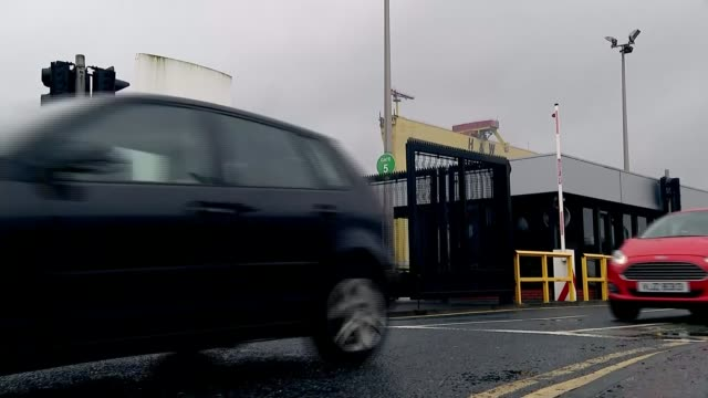 Bombardier US tariff row / Belfast jobs at risk Cars past entrance to Bombardier factory Flags on flagpoles outside