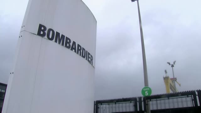 Bombardier US tariff row / Belfast jobs at risk NORTHERN IRELAND Belfast EXT Sign 'Bombardier' Wide shot of sign 'HW' at Harland and Wolff shipyard