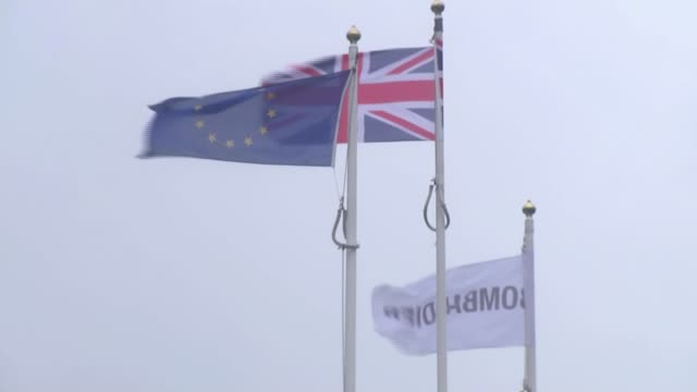 Bombardier US tariff row / Belfast jobs at risk Union flag EU flag and Bombardier flag flying Traffic along near shipyard