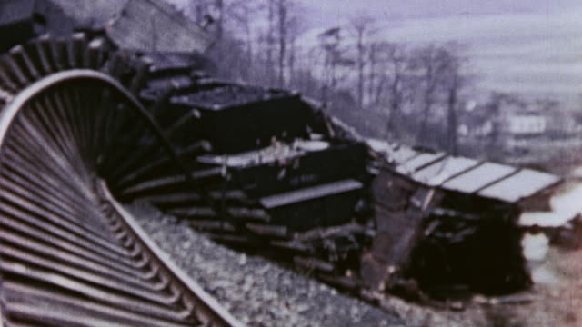 Bombed out railroad tracks twisted into a spiral and the US Third Army advancing / Germany