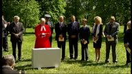 Laying of Foundation stone More of service SOT / Moment of silence held at service includes Robin Gibb and other guests standing silent / More of...
