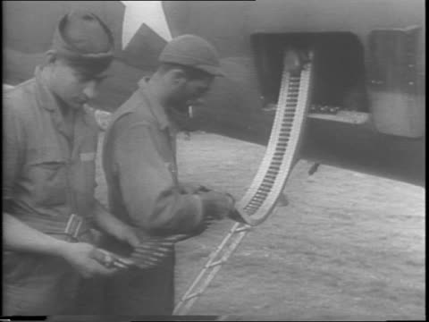 B26 bomber planes flying in formation / B26 landing on airfield / uniformed soldiers load bombs off of truck bed / soldiers load bomb into plane /...
