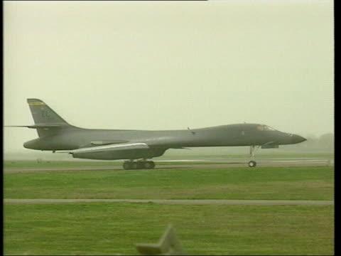 B1 bomber taxiing B1 bombers Ground crew around bomber