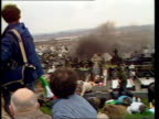 Bombers' funerals Belfast Milltown Cemetery CMS Coffin draped in tricolour held by mourners PULL OUT CBV Mourners as lower coffin into grave TILT UP...