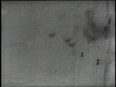 bombs dropped onto tanks / bomber flies across battlefield