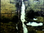Bombs dropping from US bomber plane over North Vietnamese countryside during Vietnam War / Vietnam
