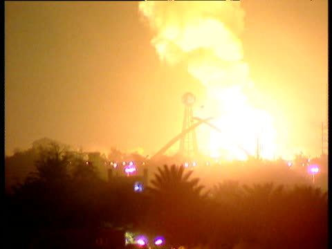 Bombs explode in night sky Hands of Victory Arch is illuminated during Iraq War Baghdad Mar 03