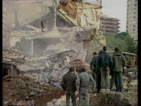 Beirut French HQ GV Aftermath of bomb blast MS Crane and bulldozer at work Night MS Stretcher bearers pick up victim MS Stretcher bearers RL MS...