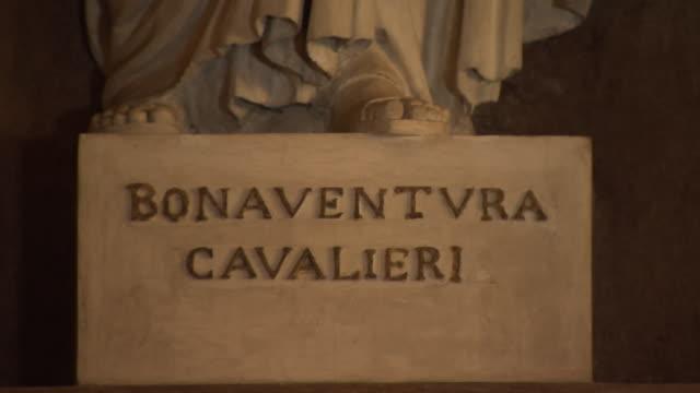 Bonaventura Cavalieri - pan up white stone statue inside Pavia University lecture theatre in Italy