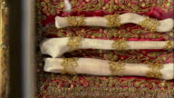 CU PAN Bones attached to ornate cushion in reliquary in St. Peter's Church, Munich, Bavaria, Germany