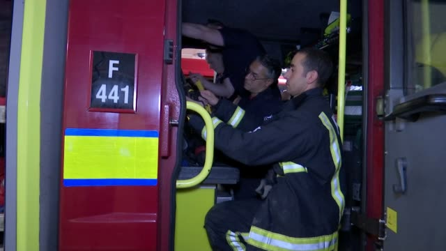 London Fire Brigade preparations ENGLAND London East Ham Fire Station Four firefighters taking off their helmets and introducing themselves to camera...