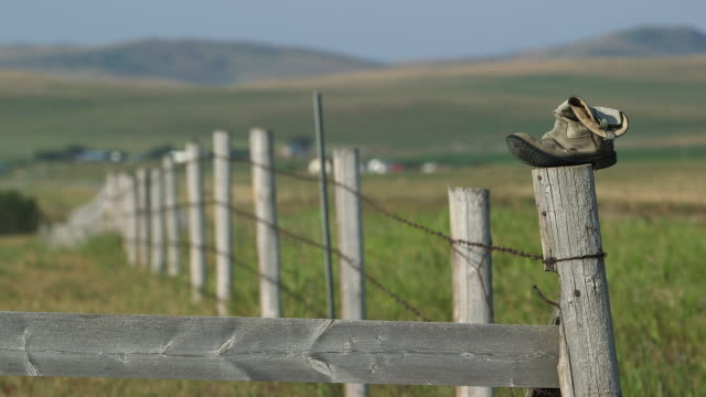 Boot on fencepost