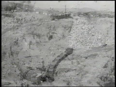 Bor copper mine HA WS Machine scooper train carts on excavated grounds MS Yugoslavian worker drilling LA MS Train car passing w/ ore