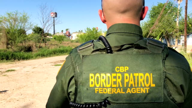 A US Border Patrol agent climbs up from the bank of the Rio Grande at the USMexico border on March 14 2017 in Roma Texas He and fellow agents had...