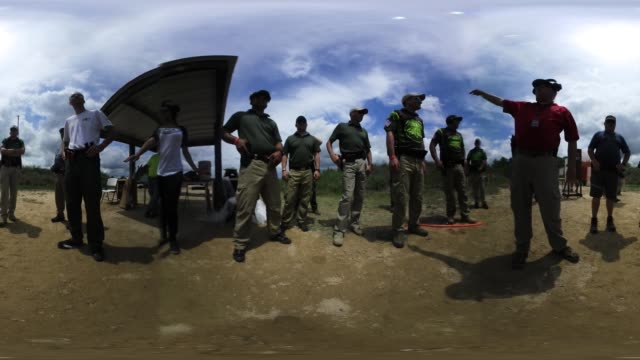 'US Border Patrol agents listen to instructions before taking part in a shooting competition at the Bandera Gun Club on April 13 2017 in Bandera...