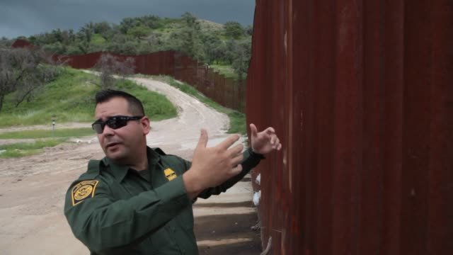 US Border Patrol Agents patrol the USMexico border in Nogales Arizona US on January 8 Wide shots and close ups of two US Border Patrol officers...