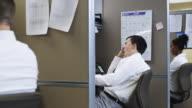 MS ZI Bored man working in office / Orem, Utah, USA